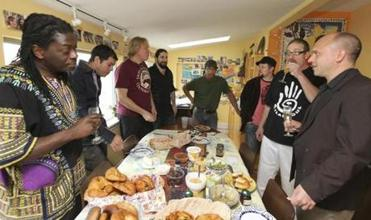 Band members and friends have a brunch before a jam session.